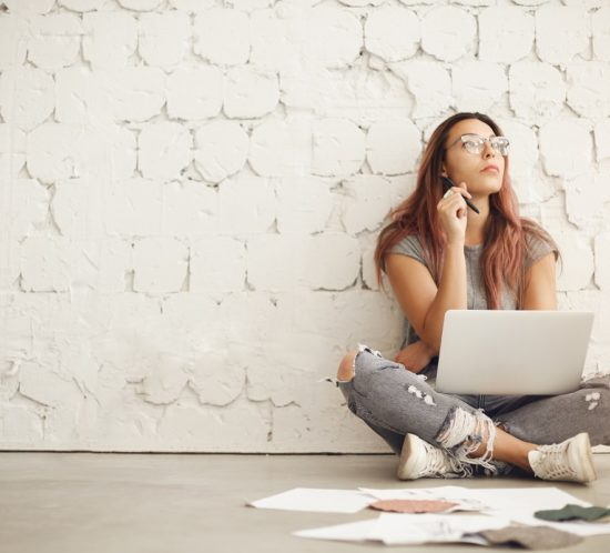 Woman sitting on floor thinking about blog posting